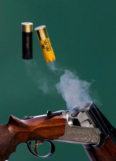 """Men's Shooting: Spent cartridges are ejected from the shotgun of Sweden's Hakan Dahlby during the men's double trap shooting qualification round at the London 2012 Olympic Games at the Royal Artillery Barracks on Aug. 2, 2012."""