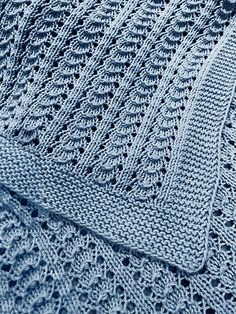"Free Knitting Pattern for 4 Row Repeat Little Shells Carseat Blanket - Baby blanket knit with a 4 row repeat shell lace pattern, with only one lace row and 3 rows all knit or purl. Aran weight yarn. 18"" wide x 22"" long though I'm sure you can adapt the size. Designed by Alka McAndrew. Pictured project by knitgirl118. Rated easy by most Ravelrers."