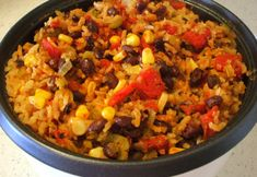 Mexican Fiesta Rice - what an easy recipe and it basically cooks itself in the rice cooker! A perfect accompaniment for tacos, enchiladas, or any other Mexican main dish. And... It's pretty healthy, too!