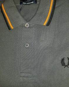 Fred Perry Laurel Collection Twin Tipped Polo Shirt- GRAPHITE / ORANGE / BLACK (Made In England!) Punk Store, Twin Tips, Fred Perry, Collar And Cuff, One Design, Punk Rock, Good Music, Polo Shirt, Graphite