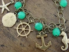 Nautical Charm Bracelet Anchor Starfish Sand Dollar by OliviaClare on etsy.