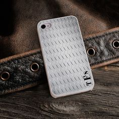 """Personalized White Trimmed iPhone Cover - Diamond Plate Steel. Turn any iPhone into a fashionable accessory with one of 15 different Personalized iPhone cases, available in a variety of designs suitable for both men and women. Made of a lightweight yet durable hard shell polycarbonate, the white-rimmed snap-one cases protect your phone from everyday scratches and dents. Personalization makes them extra unique! Measures 4 1/2"""" x 2 1/4"""" x 3/8"""".This item takes 3-4 business days to process…"""