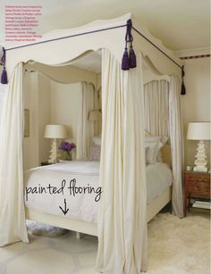 charming tassels and trip on this bed with  painted floor