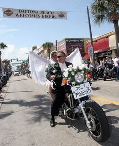 Newlyweds ride away during Bike Week (2006). | Florida Memory
