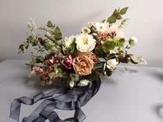 LOOOOVe the colors in this bouquet...deep green/grey, Mauve?) is that what you call it