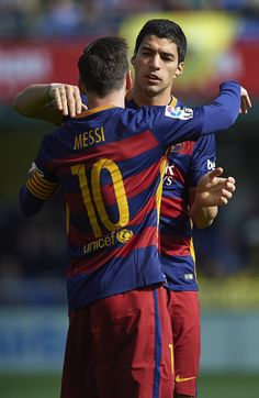 Lionel Messi and Luis Suarez of Barcelona celebrate during the La Liga match between Villarreal CF and FC Barcelona at El Madrigal on March 20, 2016 in Villarreal