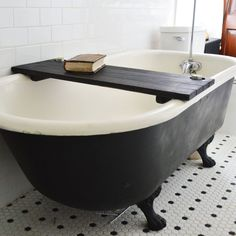 Make a relaxing statement in your elegant bath with the Wooden Tub Caddy. Place a soothing candle, book, or glass of wine on the caddy and transform your soaking experience into something that you've always dreamed of. Made out of reclaimed oak from barns built in the 1800s, the caddy has two holes drilled in the corners, perfect for a votive candle or tea light. Water-resistant and easy to clean, the caddy just needs a quick wipe-down after every use.