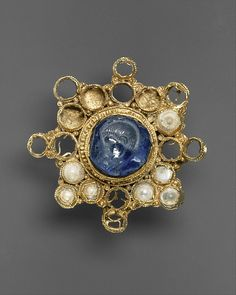 Star-Shaped Brooch with Intaglio, ca. 950-1000 (setting); 337-50 (intaglio). Ottonian; Byzantine. The Metropolitan Museum of Art, New York. The Cloisters Collection, 1988 (1988.15)