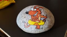 Dog ready to go swimming painted rock