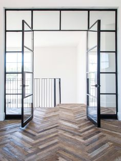 Steel doors and reclaimed wood chevron pattern. Steel doors and reclaimed wood chevron pattern. The post Steel doors and reclaimed wood chevron pattern. appeared first on Glas ideen. House Design, Glass House, Interior, Steel Frame Doors, Home, House Interior, Herringbone Floor, Flooring, Interior Design