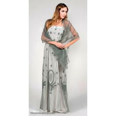 The light fabrics in silver with vertical empire embrodiery look great both on regular ladies and plus sized ones. The long length of the dress visually smoothes the silhouette as well as making petite figures look taller.