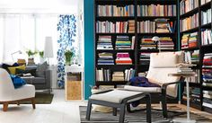 Bookshelf corner - dark shelves paired with light floors and furniture accents to keep the room bright