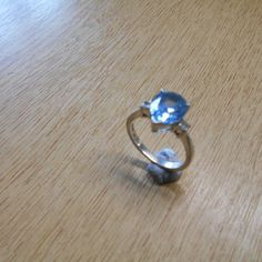 A Silver Blue Pear Shape Topaz and CZ Ring.