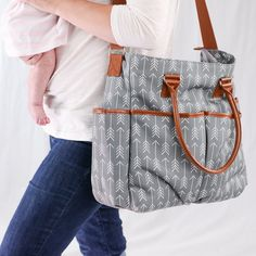 Diaper Bag by Danha - Plus Matching Baby Changing Pad.  STYLISH, ELEGANT DESIGN THAT WILL GRAB THE ATTENTION: If you want to be an elegant, stylish parent, this baby diaper bag is exactly what you have been looking for! The modern and classic grey background color along with the impressive arrow patterns are bound to make you the center of attention.