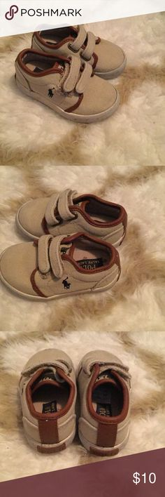 Polo Ralph Lauren Ethan Low EZ Sneaker Toddler boy's Polo Ralph Lauren shoes in tan and brown with blue horse logo. These are in decent condition, but the Velcro snap on the right shoe came apart. This is an easy fix if you can see. See the last picture. Polo by Ralph Lauren Shoes Sneakers