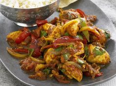 A spicy chicken curry made with chiles and mustard seeds. Good with basmati…