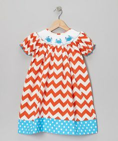Loaded with lively style and cheer, this zigzag-swept bishop dress covers darlings in breezy comfort and colorful charm. Sweet smocked crabs scuttle across the top, and a polka dotted trim adds a kick of spunk along the bottom.