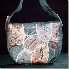 Machine embroidered with a lacey look.  The back of this purse is quilted (stippling).  Handbag design by BFC-Creations.