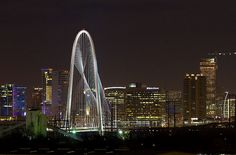 The bridge rises above the Trinity River 400 feet and is composed of 58 cables some to be eight inches thick which extend in weblike sweeps to either side. This bridge now provides easy access from downtown to the neighborhood of West Dallas. Designed by the visionary architect Santiago Calatrava.