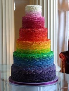 so many dots of rainbow buttercream     by Rachelle's Cakes