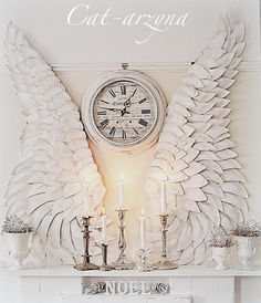 Check out this stunning mantel. Giant angel wings are constructed from paper plates! I love this. Head over to Cat-arzyna for the details. You will likely need to use Google translate. Amazing...