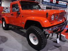 Here is a picture of one of the Jeep J-10 prototype models we took at the SEMA show in Las Vegas. Basically it is a JK with J-Truck bumpers and hood. Then they beefed up the suspension and tires.