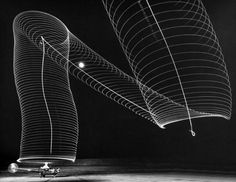 Multiple exposure of lights on blades of grounded Sikorsky helicopter forming slinky-like pattern in the sky as rotors turn. By Andreas Feininger