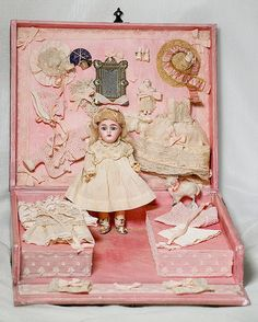 Pretty doll in a pretty pink box with her little wardrobe