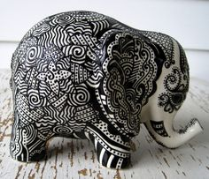Lucky Elephant Bank -- White Ceramic Elephant with Black Embossed design on top.. $120.00, via Etsy.