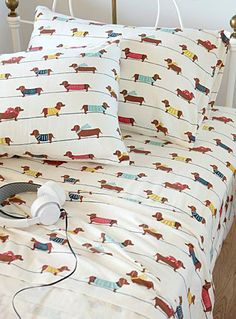 Simons, DACHSHUND DOGS FLANNEL SHEET, STARTING AT $19.99 Style: 3543-2131141 Our 100% brushed cotton flannel sheets, imported from Portugal that are soft and warm, and will help you sleep better during the cold season. - Cute endearing dogs with their sweaters and scarves in accent red, turquoise, navy and yellow. - Pillowcases available in standard and king sizes, set of 2 per package.