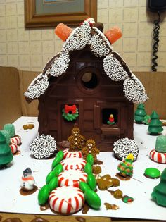Chocolate house I made with my nephew! We used melting chocolate, molds, and candy! Chocolate House, Chocolate Molds, Melting Chocolate, Christmas Time, Christmas Crafts, Christmas Decorations, Ginger House, Candy House, Candy Molds