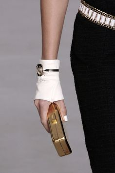 Chanel - those gloves with the white nails are perfection