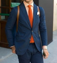 Shop this look for $158:  http://lookastic.com/men/looks/blazer-and-tie-and-longsleeve-shirt-and-chinos-and-pocket-square/436  — Navy Blazer  — Orange Knit Tie  — Orange Gingham Longsleeve Shirt  — Navy Chinos  — White Pocket Square