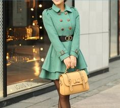 mint green coat and understated yellow purse