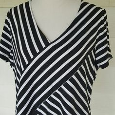 Black and white stripe top Asymmetrical stripe top. Super flattering.  Black and white. Short sleeves. Size xxl. Measures 24 bust 30 length. ...rbx Tops Tunics