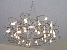 Repurpose vintage old bedsprings into a chandelier light fixture.  Salvage, upcycle, recycle bed springs.