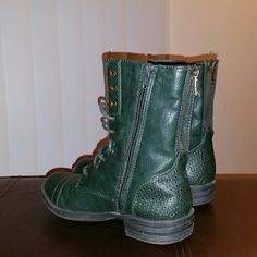 Dark Green Combat Boots Dark Green Combat Boots  Great Condition!Zipper on back and side can be worn unzipped!Size 5!!! American Rag Shoes Combat & Moto Boots