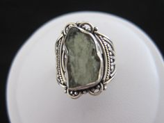 A personal favorite from my Etsy shop https://www.etsy.com/listing/245174522/moldavite-sterling-silver-ring-size-65