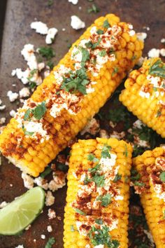 Liven up corn with this delicious mexican recipe, made with cojita or feta cheese, chilli salt, coriander and lime