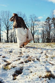 my Trash the Dress in the mud & snow! Photo by: Kidd Photography