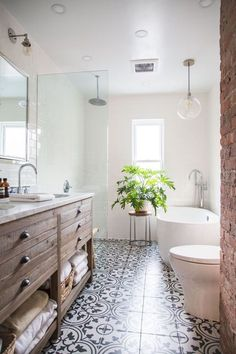 BECKI OWENS - Pinterest Top 10 - Visit the blog to see the top trending images on my boards this month! Like this pretty black + white + wood farmhouse bath.