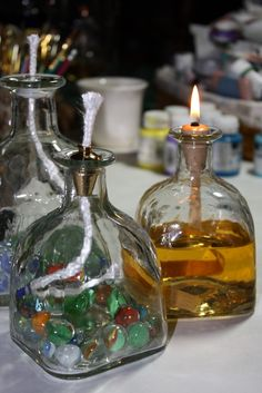 sprinkled blessings studios: Vintage marbles, discarded Patron bottles and light from darkness! Patron Bottle Crafts, Alcohol Bottle Crafts, Glass Bottle Crafts, Wine Bottle Art, Alcohol Bottles, Diy Bottle, Bottles And Jars, Patron Bottles, Empty Liquor Bottles