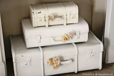 Don't like the color of your vintage suitcases? Just shabby them up with some paint & silk flowers!