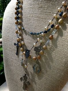 One of a Kind Multi-Strand Antique and Vintage Rosary Necklace with 5 Medals and Seven Sorrows Crucifix. $175.00, via Etsy.