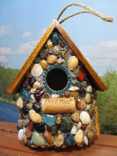 Tropical Mosaic Birdhouse features a mini sand dollar,a sea horse,sea shells,wine corks,beach glass and ocean agates from the Oregon Coast.