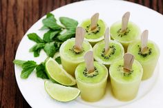 Kiwi Mojito Popsicles--I'm not interested in the mojito part; I like the kiwi slices on the popsicles! I would do this for my little kiwi fanatic, with a different popsicle mixture, and maybe put kiwi slices on the top too! Frozen Desserts, Frozen Treats, Yummy Drinks, Yummy Food, Delicious Fruit, Brownie Desserts, Popsicle Recipes, Kiwi Recipes, Summer Treats