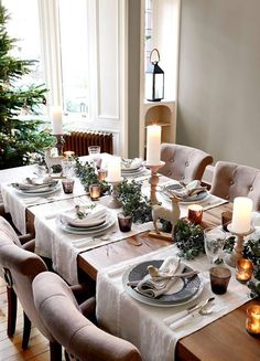 Christmas dining room ideas - Make your centerpieces shine - candlesticks, Christmas novelties and tealights complete a chic dining look for Christmas. #'diningroomtablecenterpieces'
