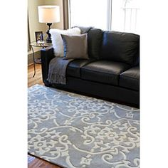@Overstock - This hand-tufted rug features a durable and allergen-free poly-acrylic construction. Shades of white and grey highlight this rug.http://www.overstock.com/Home-Garden/Hand-tufted-Grey-Floral-Rug-5-x-8/5509808/product.html?CID=214117 $157.99