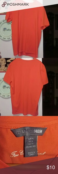 H&M tshirt, XL I am selling a H&M T-shirt. It is an XL and under the tag it says, Fine Cotton Stretch. It is made of 95% cotton and 5% elastane. It is just a basic T-shirt that is a beautiful bright orange. H&M Tops Tees - Short Sleeve