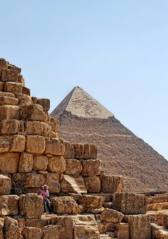 Pyramids in Giza, Egypt - I paid 10$ to the officer that was guarding the site to take this photo of me on the pyramid. Later i found out that the officers are the biggest thieves around and i am lucky i didn't lose my camera. Many travelers told me the same thing, so if you are going here, keep your valuable stuff near you or on you. #Giza #Pyramids #Egypt
